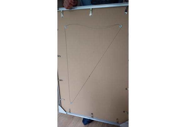 Fotolijsten, karton en gebroken glas - IMAG1229