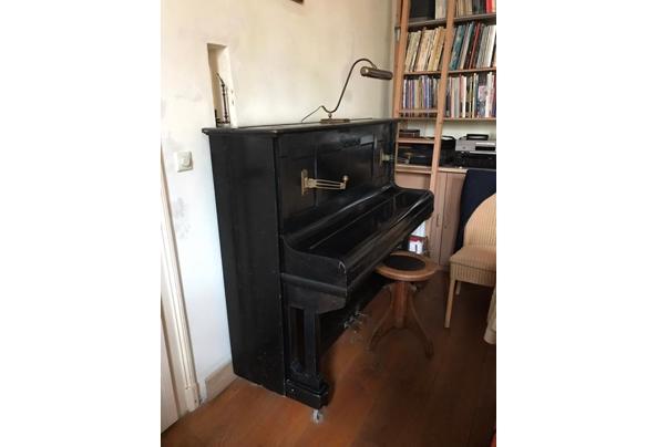 Beetje vals, maar verder nog prima piano. Heeft mij jaren goede dienst bewezen - 93F32436-C84D-4A28-BDEC-FFED79B9F685.jpeg